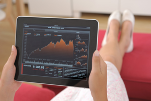 woman-looking-at-stocks-on-ipad_pv3m4b